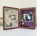 """Sweet Memories""Mixed media assemblage (4 ¼"" x 5 ½"" x 2""). Exterior – cigar box, walnut stain - silver label. Interior – silver leaf & laminated chenille - personal mementoes – reproduction prints"