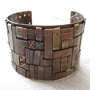 Woven cuff with stitching Copper, new gold, nickel, silver rivets, galvanized wire